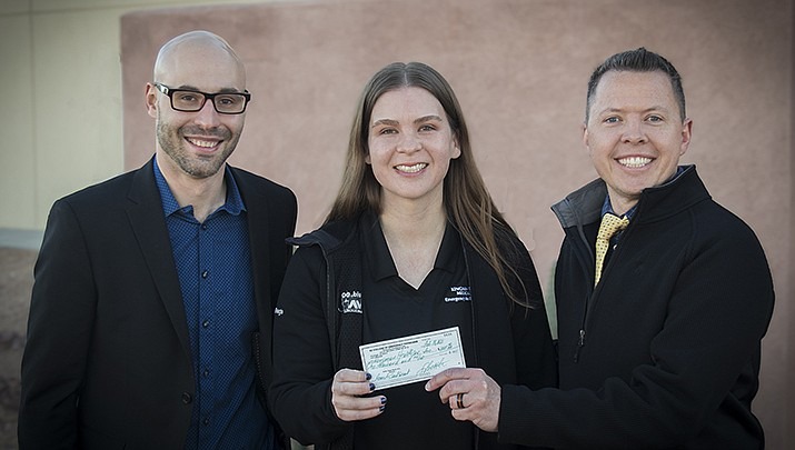 Sasha Reid, DO, the administrative chief resident at Kingman Regional Medical Center, has been awarded with a $1,000 research seed grant by the Arizona College of Emergency Physicians. She is shown with, left, Anthony Santarelli, PhD, KRMC clinical research administrator, and Adam Dawson, DO, medical director of KRMC's Emergency Department. (KRMC courtesy photo)