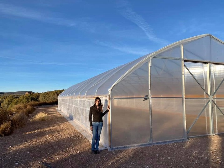 Kaylee Baker, instructor for the upcoming Zero Waste Living lectures, poses at her new High Tunnel Greenhouse at Rock Farms, getting ready to plant vegetables and flowers. (Photo courtesy of KCA)