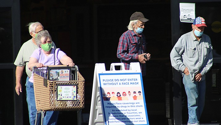 A survey of grocery store workers in Arizona by the University of Arizona reveals that about 20% of employees are anxious about customers not wearing masks in stores. Shoppers are shown leaving the Safeway grocery store at 3125 Stockton HIll Road in this October, 2020 photo. (Miner file photo)
