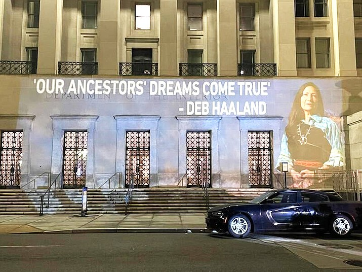 New Mexico U.S. Rep. Deb Haaland's image is projected on the side of the U.S. Department of the Interior building in Washington, D.C. Feb. 22, prior to her confirmation hearing Feb. 23. (Leah Salgado via AP)