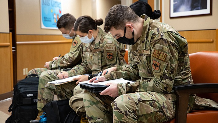 U.S. Air Force personnel complete paperwork to begin in-processing after arriving at Kingman Regional Medical Center on Sunday, Feb. 28 to help relieve hospital personnel during the coronavirus pandemic.  (U.S. Army photo by Spc. Michael Ybarra, 5th Mobile Public Affairs Detachment/Public domain)