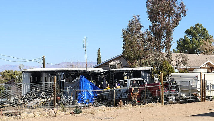 After the fire was extinguished, the remains of at least two people were located inside the residence, according to a Mohave County Sheriff's Office new release. The identities of the deceased are unknown at this time. (Photo by Travis Rains/Kingman Miner)
