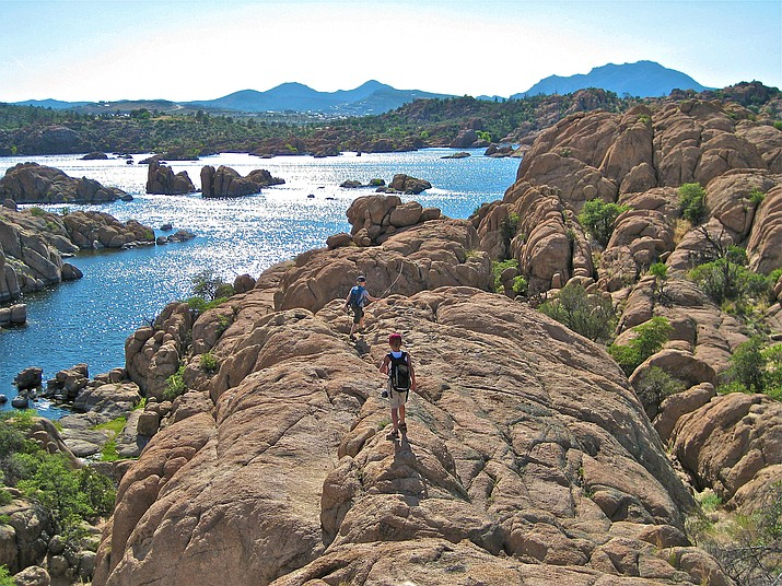 Young hikers take to the Lakeshore Trail along the shores of Watson Lake. With the COVID-19 shutdown in the spring of 2020, many families gravitated to outdoor activities, and the city's trail usage shows a dramatic spike in 2020. (Chris Hosking, City of Prescott/Courtesy)