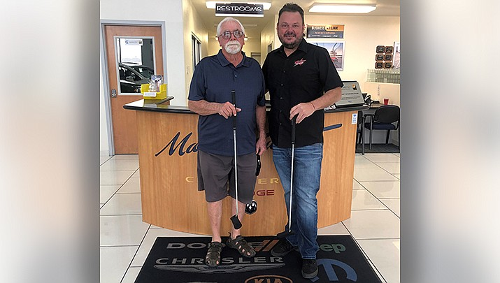 Mike Hopper, left, shot a hole-in-one on the par 3 No. 6 hole at Cerbat Cliffs Golf Course winning a free putter from Martin Swanty Chrysler Dodge Jeep Ram. Cody Swanty, right, congratulated Hopper. (Courtesy photo)