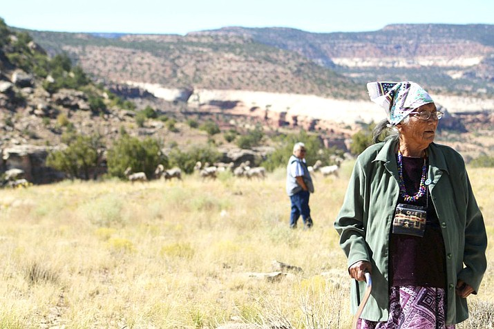 In 2019, Annie Henry and Gilbert Badoni revisit the area where they used to live at a uranium mining camp in Slick Rock, Colorado, and found remnants of their former homes. On Feb. 11, the U.S. Environmental Protection Agency (EPA) announced three contract awards for cleanup efforts at more than 50 abandoned uranium mine sites in and around the Navajo Nation. (Kathy Helms/Gallup Independent via AP)