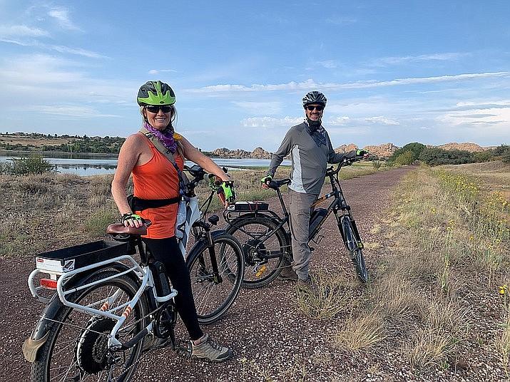 A Prescott couple enjoys a trail ride near the Granite Dells on their e-bikes. (Prescott E-bike Rentals and Tours/Courtesy)
