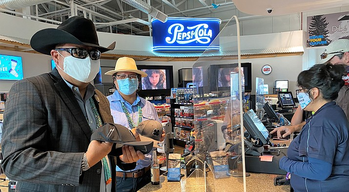 Navajo Nation Vice President Myron Lizer's temperature purchases at Navajo Blue Travel Plaza . Plexiglass between patron and before entering Navajo Blue Travel Plaza. Team members. (Photo/NNGE)