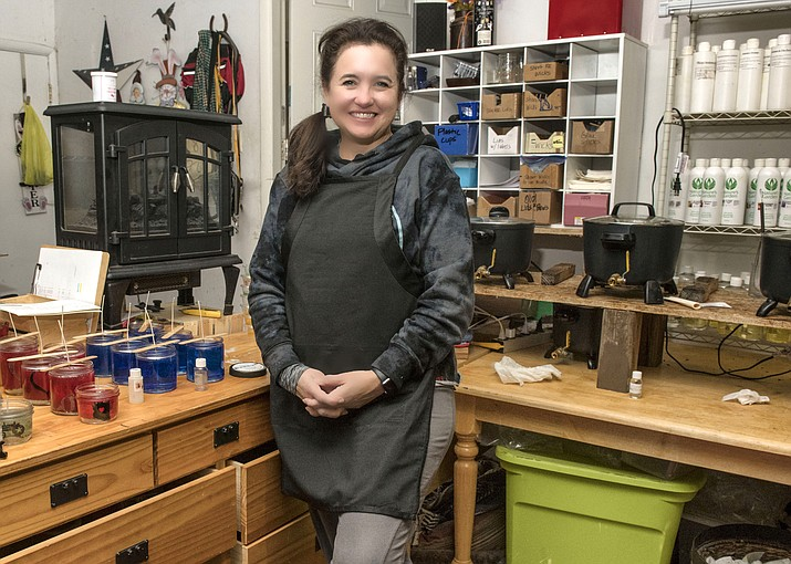 Marisa Clark works from her home at the Grand Canyon where she and her husband, Chris, make and sell gel candles. (V. Ronnie Tierney/WGCN)
