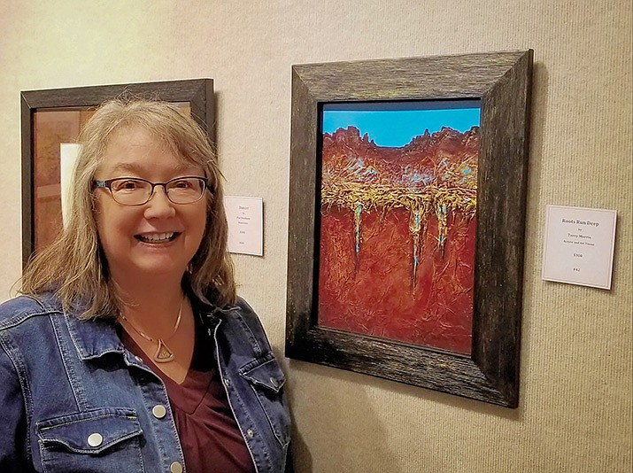 """Terry Ann Morris, shown here with her painting """"Roots Run Deep,"""" was elected as the February Artist of the Month by the members of El Valle Artist Association."""