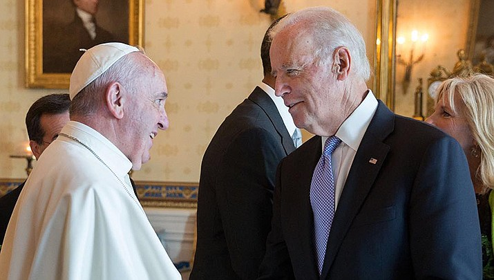 Pope Francis, seen shaking hands with then-Vice President Joe Biden in 2015, has approved a statement by the Vatican's Congregation for the Doctrine of the Faith, that the church can't bless same-sex unions. (Official White House photo/Public domain)