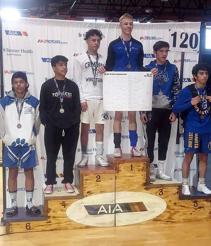 Chino Valley wrestler Colby Evens, standing on the No. 1 podium, finished his senior season as an unbeaten Division 3 state champion in the 120-pound weight class March 18, 2021, at Poston Butte High School in San Tan Valley near Phoenix. (Allen Foster/Courtesy)