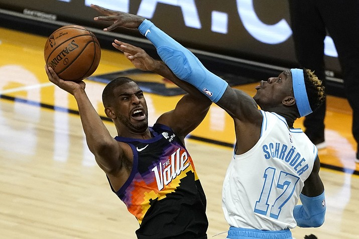 Phoenix Suns guard Chris Paul gets fouled by Los Angeles Lakers guard Dennis Schroder (17) during the second half of an NBA basketball game, Sunday, March 21, 2021, in Phoenix. (Rick Scuteri/AP)