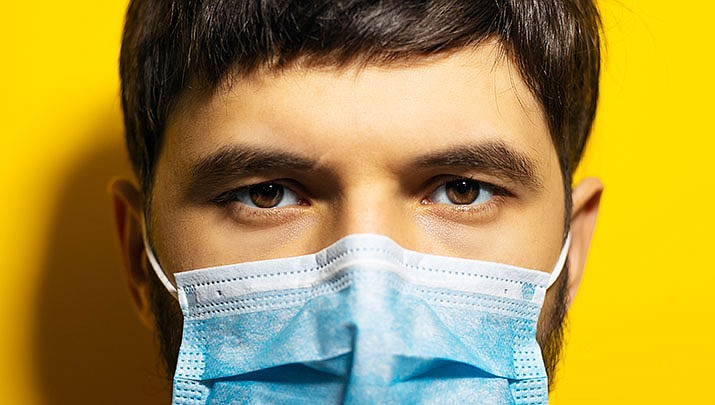The widespread use of masks and plastic gloves during the pandemic has resulted in a worldwide pollution problem. (Adobe image)