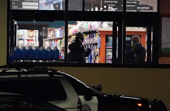 Police continue their investigation at a King Soopers grocery store where authorities say multiple people were killed in a shooting, Monday, March 22, 2021, in Boulder, Colo. (AP Photo/David Zalubowski)