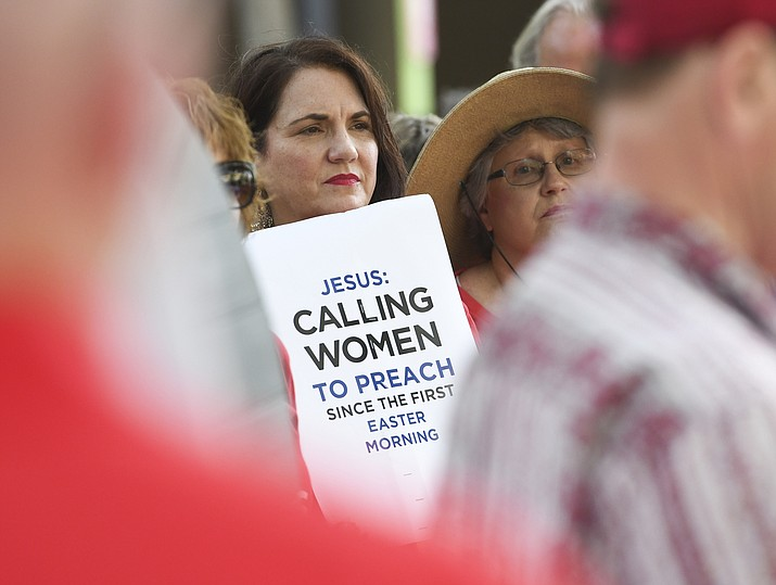 In this Tuesday, June 11, 2019 file photo, Janene Cates Putman of Athens, Tenn., holds a sign during a demonstration outside the Southern Baptist Convention's annual meeting in Birmingham, Ala. Among the millions of women belonging to churches of the Southern Baptist Convention, there are many who have questioned the faith's gender-role doctrine and more recently urged a stronger response to disclosures of sexual abuse perpetrated by SBC clergy. (Julie Bennett/AP)
