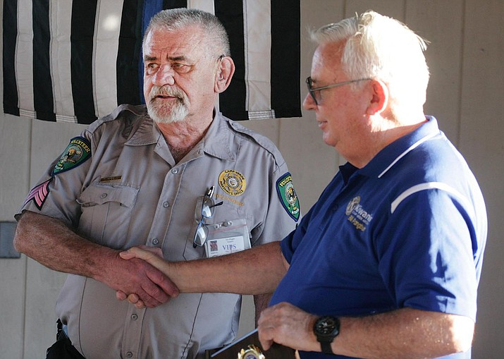 Tim Wiggle, left, a volunteer with the Camp Verde Marshal's Office, receives the department's 2019 Law Enforcement Service Award from Bill Pangburn of the Camp Verde Kiwanis. Wiggle, sergeant with the department's Volunteers in Policing program, will retire on April 5. VVN/Bill Helm