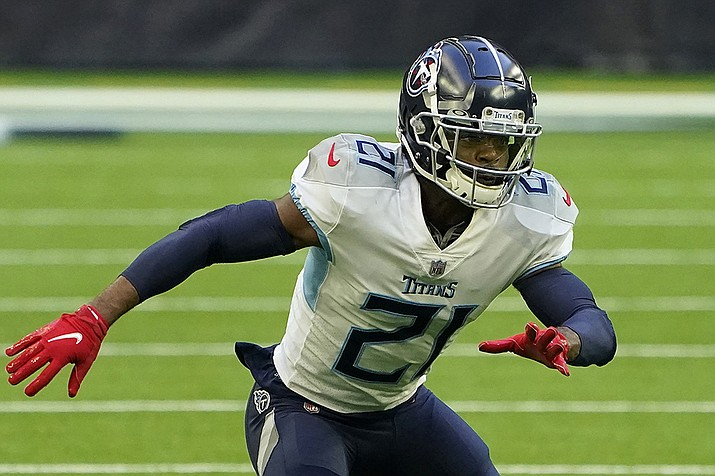 Then-Tennessee Titans cornerback Malcolm Butler (21) defends against the Houston Texans during the first half of an NFL football game in Houston, in this Sunday, Jan. 3, 2021, file photo. The Arizona Cardinals added cornerback Malcolm Butler, Thursday, March 25, 2021, on a one-year deal in an effort to bolster a thin secondary.(Eric Christian Smith, AP File)