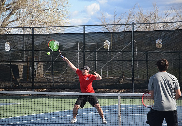Mingus Union junior Silas Russel reaches for a volley at the net in Wednesday's No. 1 doubles match against Williams Field. The Marauders lost the season-opening dual to Williams Field, 9-0, and host Lee Williams on Monday at 3:30 p.m. VVN/Jason W. Brooks