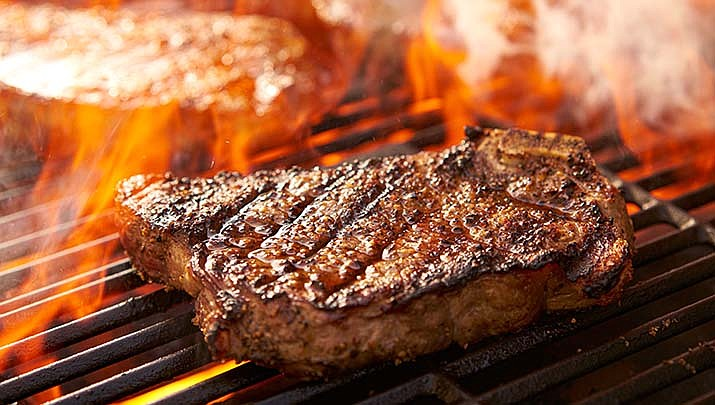 Grilling is a great way to prepare delicious low-fat, low-calorie meals. Foods naturally lose fat as they cook on a grill. (Adobe image)
