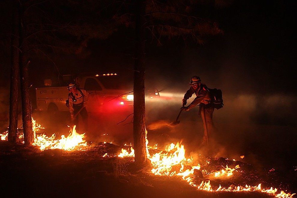 Firefighters work through the night on the 2020 Mangum Fire.