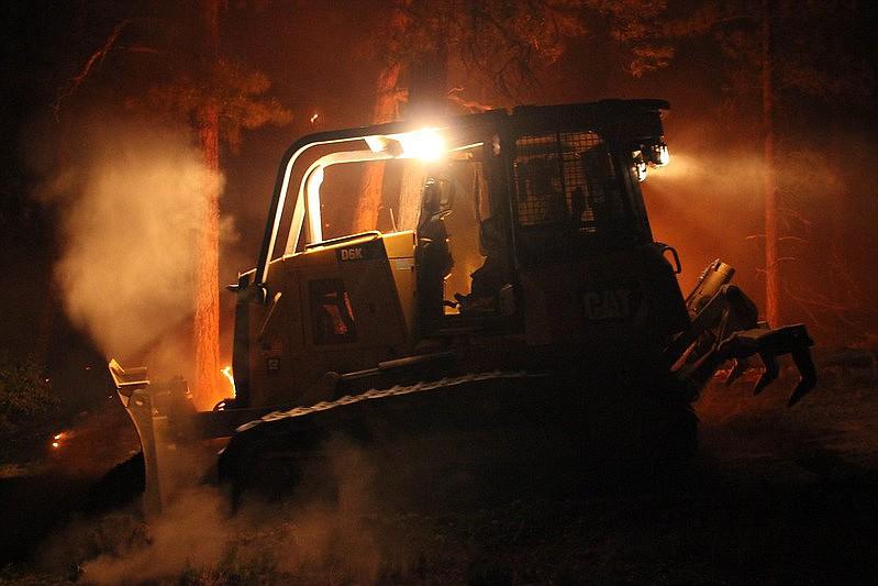 A dozer operator works through the night on the 2020 Mangum Fire.