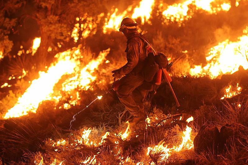 A firefighter backburns on the 2020 Mangum Fire.