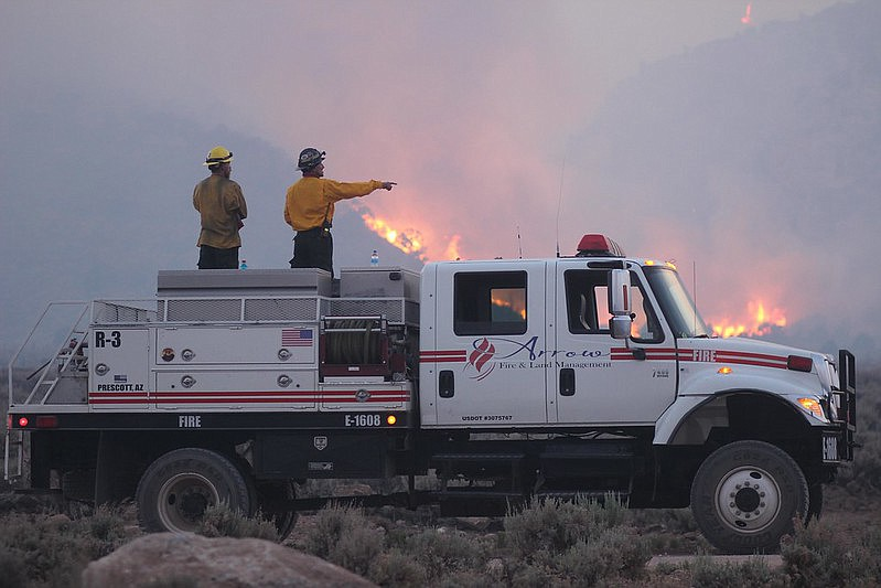 Firefighters from Arrow Fire and Land Management of Prescott work the 2020 Mangum Fire.