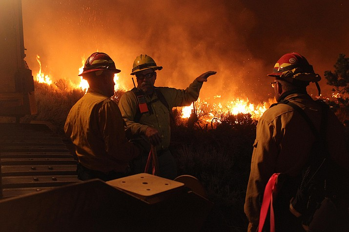 McCall smokejumpers work night shift operations on the Mangum Fire June 22, 2020. The quick moving fire burned 71,450 acres on the Kaibab Plateau. The fire threatened to run through the Jacob Lake area. (Photo/Kaibab National Forest/Mike McMillan)