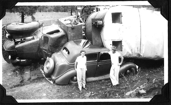 A couple poses with their vehicle following a wreck on Ash Fork Hill circa 1947. (Photo/Messimer family)