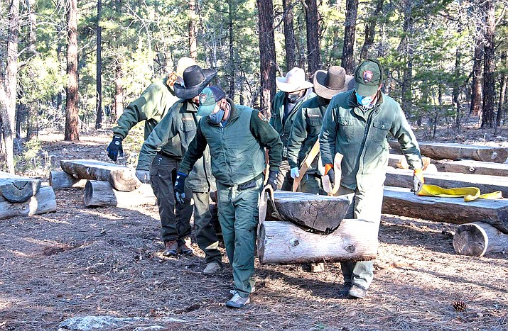 Members of Grand Canyon National Park's trail crew relocate wooden benches to be used at Yavapai Point Amphitheater on the South Rim of the park. (Photo/NPS, Mike Quinn)
