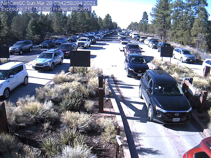 Four long lines of vehicles wait to enter Grand Canyon National Park's south entrance. The south entrance via the town of Tusayan is currently the only entrance open at the park. (Photo/NPS)