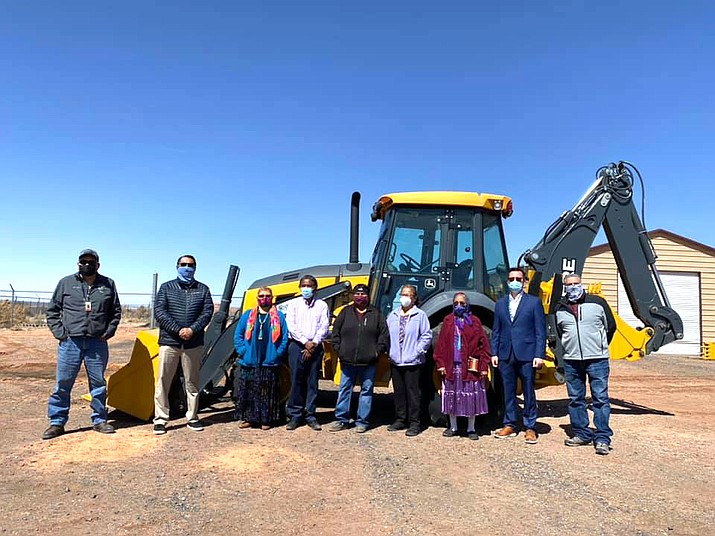 Rock Point Chapter President Patterson Yazzie, Vice President Janice Lee Jim, Secretary/Treasurer Nancy Harvey, Farm Board Member Bobby Yazzie and Community Services Coordinator Charlene Kirk, along with Navajo Nation President Jonathan Nez travelled to Rock Point as the community received a new backhoe March 22. (Photo/Office of the President and Vice President)