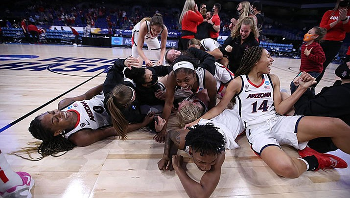 The University of Arizona women's basketball team celebrates advancing to the Final Four of the NCAA tournament. (University of Arizona Athletics courtesy photo)