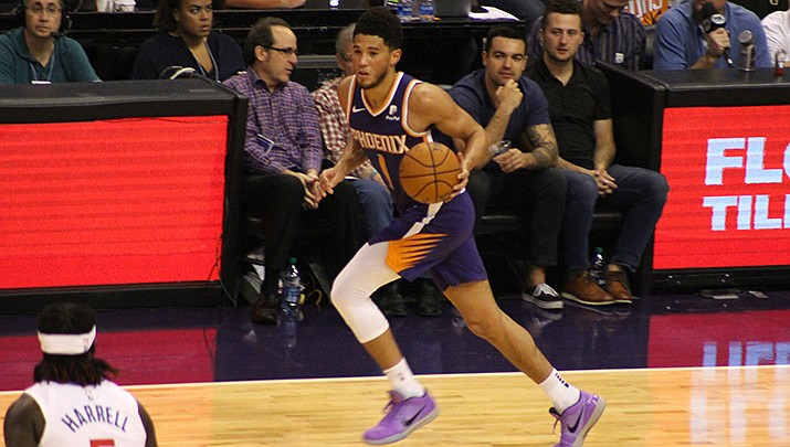 Devin Booker scored a team-high 21 points to lead the Phoenix Suns to a 117-110 win over the visiting Atlanta Hawks in an NBA basketball game on Tuesday, March 30. (Miner file photo)