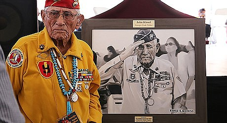 Navajo Code Talker John Kinsel stands next to an oil portrait based on a photograph by Kenji Kawano. The Office of the President and Vice President provided these portraits as gifts for the surviving Navajo Code Talkers. (Office of the President and Vice President)