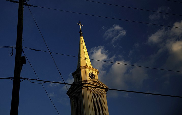 In this Tuesday, April 11, 2017 file photo, the sun sets on a Baptist church in Georgia.  For the first time since the late 1930s, fewer than half of Americans say they belong to a church, synagogue or mosque, according to a new report from Gallup, Tuesday, March 30, 2021.(David Goldman/AP)