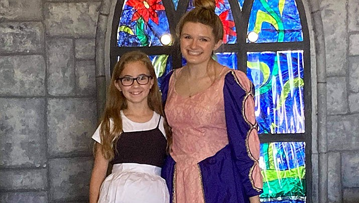 Mollie Taylor, left, and Amber Wisely, a senior at Lee Williams High School, pose for a photo. Taylor will play Rapunzel, and Wisely, who is directing the play, will make a cameo as Rapunzel's mother. (Photo by Agata Popeda/Kingman Miner)