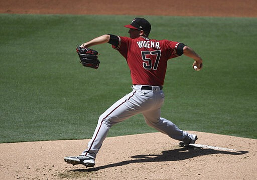 Arizona Diamondbacks starting pitcher Taylor Widener winds up during the first inning of the team's baseball game against San Diego Padres on Sunday, April 4, 2021, in San Diego. (AP Photo/Denis Poroy)