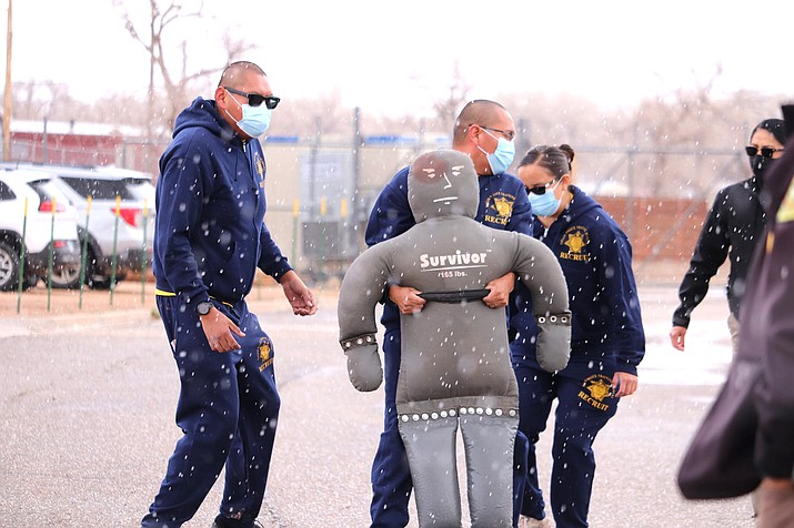 Navajo Police Training Academy Class 56 recruits demonstrate the body drag test for applicants. Class 56 is expected to graduate in September 2021. (Photo/NNPD)