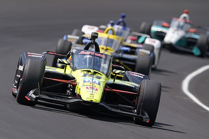 Santino Ferrucci drives into turn one during the Indianapolis 500 auto race at Indianapolis Motor Speedway in Indianapolis, in this Sunday, Aug. 23, 2020, file photo. Ferrucci has landed a ride for the Indianapolis 500 with Rahal Letterman Lanigan Racing. The team finished first and third in last year's race with Takuma Sato and Graham Rahal, while Ferrucci was fourth. Now RLL will return to Indy with a driver lineup that claimed three of the top four spots a year ago.(Darron Cummings, AP File)