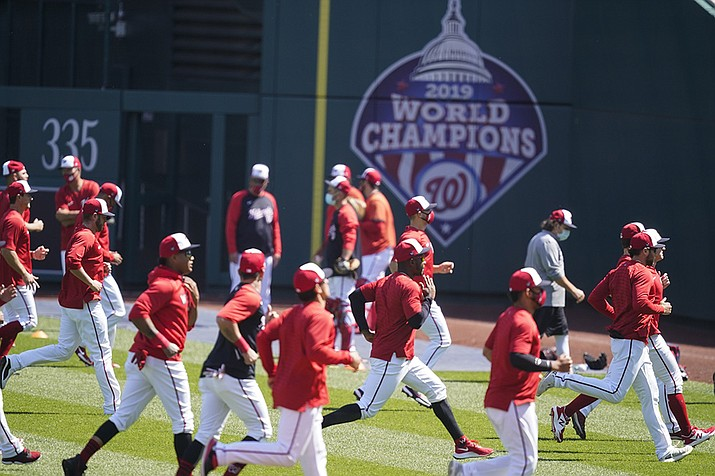 Washington Nationals warm up during a baseball workout at Nationals Park, Monday, April 5, 2021, in Washington. The Nationals are scheduled to play the Braves on Tuesday. (Alex Brandon/AP)