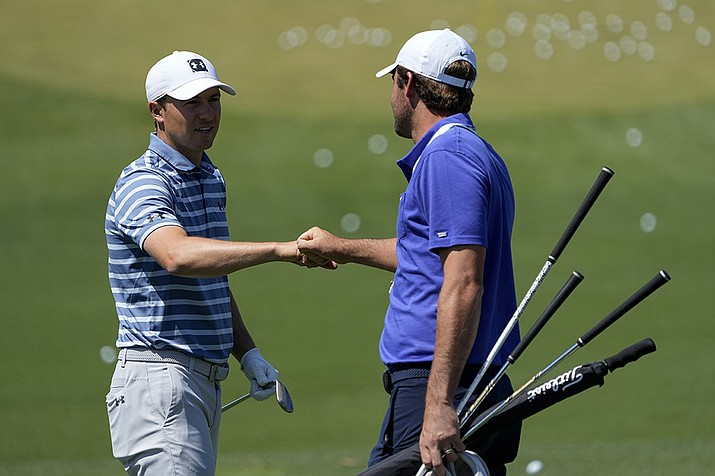 Jordan Spieth and Scottie Scheffler meet the range during a practice day for the Masters golf tournament on Monday, April 5, 2021, in Augusta, Ga. (AP Photo/David J. Phillip/AP)