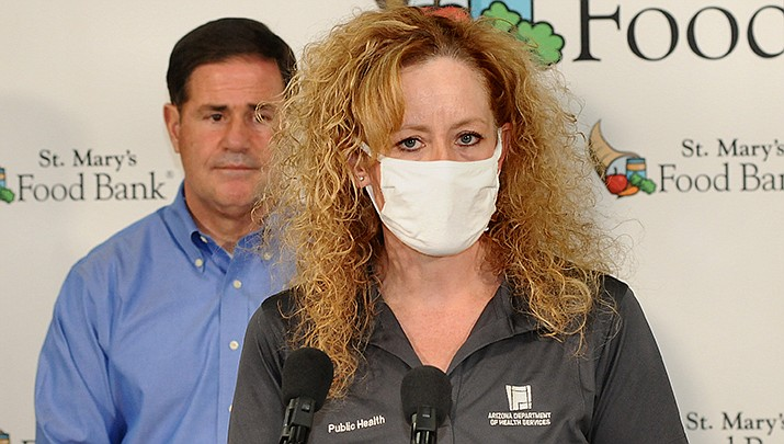 COVID-19 cases are rising again, but deaths remain down in Arizona. State Health Director Dr. Cara Christ is shown. (File photo by Howard Fischer/For the Miner)