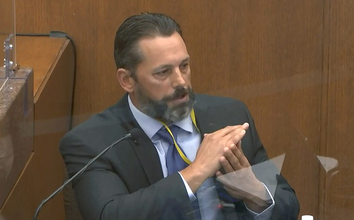 In this image from video, Minneapolis Police Lt. Johnny Mercil, a use of force trainer, testifies as Hennepin County Judge PeterCahill presides Tuesday, April 6, 2021, in the trial of former Minneapolis police Officer Derek Chauvin at the Hennepin County Courthouse in Minneapolis. Chauvin is charged in the May 25, 2020 death of George Floyd. (Court TV via AP, Pool)
