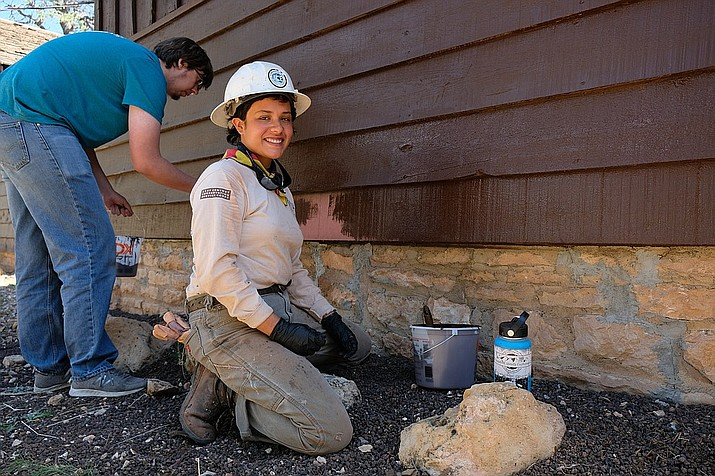 Volunteers at Grand Canyon National park paint some of the park's historic cabins in 2018. National Parks are celebrating National Park Week April 17-25. (Photo/WGCN)
