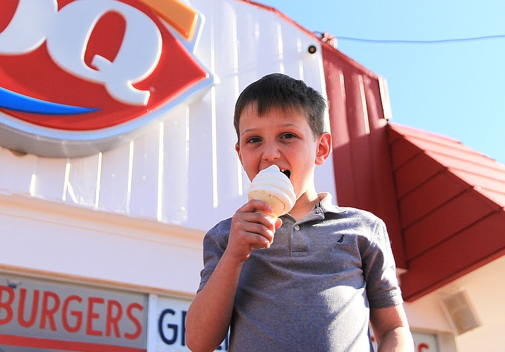 Erik Hacker of Chicago, Illinois enjoys an ice cream at Dairy Queen in Williams March 31. The annual opening of the business typical marks the unofficial beginning of spring for local residents. (Wendy Howell/WGCN)