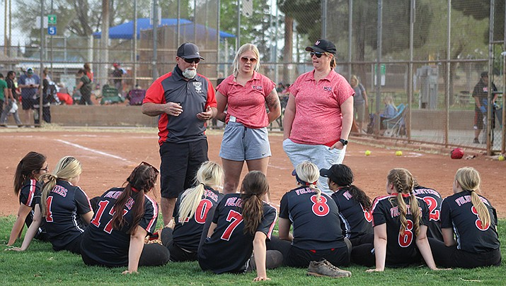 Lee Williams High School softball coaches talk to their team after a 17-1 loss to visiting Flagstaff on Monday, April 5. (Photo by Casey Jones/Kingman Miner)
