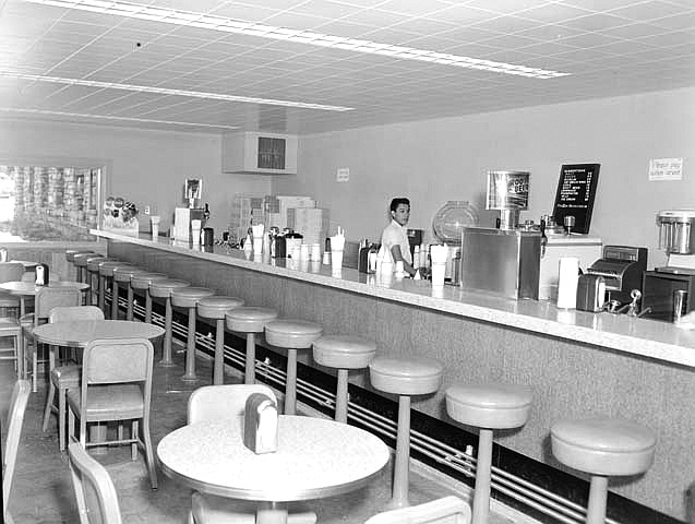 An employee works the counter at the Bright Angel Soda Fountain in 1959. (Photo/NPS)