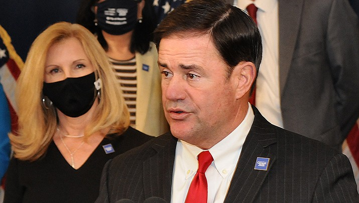 Arizona Gov. Doug Ducey has signed a bill giving businesses immunity from lawsuits over COVID-19. (File photo by Howard Fischer/For the Miner)