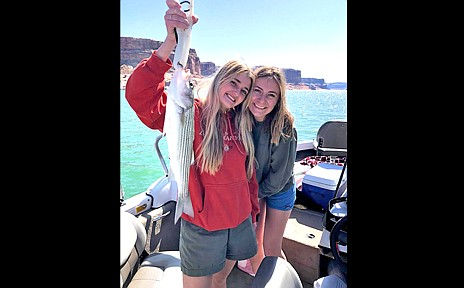 Rylee Andrus and Amber Romm with a striper.(Submitted photo)